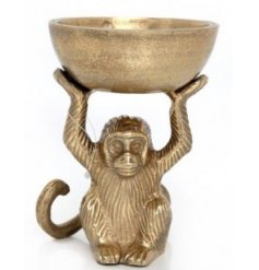 A chic monkey ornament with bowl in an antique gold finish. A unique and stylish decorative accessory.