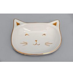 A charming cat themed trinket dish decorated with a golden accents and a smooth glaze finish