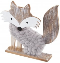 A rustic wooden fox decoration with a woolly grey coat. A chic decoration for the home.
