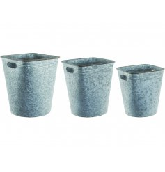 A set of 3 silver metal planters with carry handles.