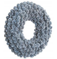 A beautiful wreath made up from baby pinecones with a whitewashed finish.