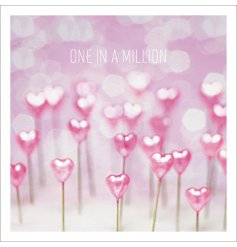 A pretty pink greetings card featuring a 'One In A Million' text and heart decal