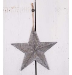 A rustic style 3D wooden star with a grey washed finish. Complete with rustic hanger and bead.