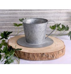 Bring a charmingly vintage feel to your garden space with this white washed zinc planter