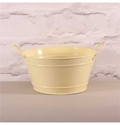 A rustic style cream zinc bowl with twin handles. Ideal for a country living kitchen, for storage and planting.