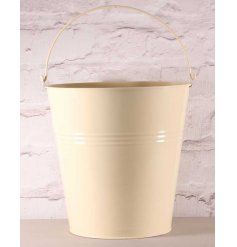A shabby chic style multipurpose bucket with handle.