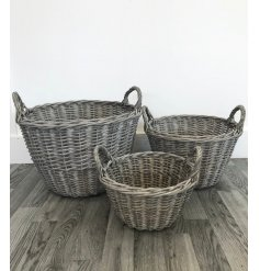 A rustic set of three round willow baskets. A great addition to many rustic homes.