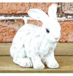 A shabby chic style white bunny ornament with a wooden effect finish.