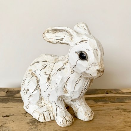A charming polyresin rabbit ornament with a carved wood effect finish.