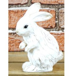 A shabby chic style rabbit decoration with a wood effect finish.