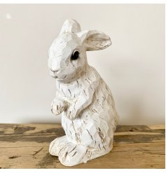 A charming polyresin rabbit decoration with a carved wood effect finish. A shabby chic decoration for the home.