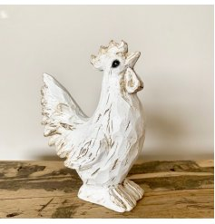 A charming white hen decoration with a carved wooden effect finish. A country living interior accessory and gift item.