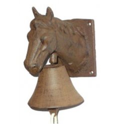 A country living style cast iron bell with a horse wall decoration.