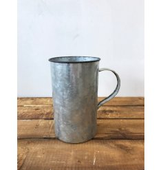 A rustic and unique camping cup style planter/vase with a distressed finish.