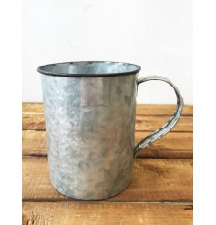 A charming and unique zinc camping cup style planter with a distressed finish.