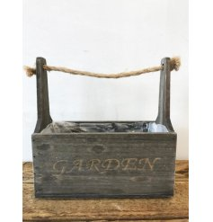 A rustic style wooden trough planter with a chunky rope carry handle and garden sign.