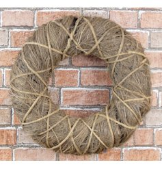 A natural brown twig wreath with woven strands. A shabby chic style decoration for the home, garden and events.