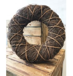 A country style wrap twig wreath in natural. A charming decoration for the home, garden and special events.