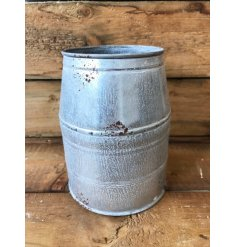 A zinc metal planter with a distressed finish. A unique planter and decoration for the home.