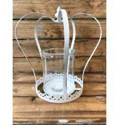 A rustic, antique style metal crown in white with a t-light holder.
