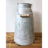Add some rustic character to the home with this charming metal churn with wooden handle.