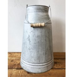 A charming milk churn with wooden handle. Complete with a distressed finish.