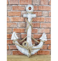 A coastal inspired large wooden anchor with a black wash and chunky rope detailing.
