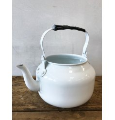 A charming and unique vintage teapot planter with handle.