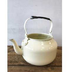 A fabulous vintage inspired cream metal teapot planter. A unique gift item and home decoration.