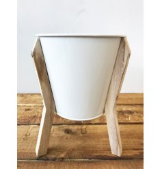 An attractive metal planter with wooden stand. A unique gift item and interior accessory.