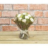 A beautiful and unique wooden floral bouquet with cream roses encased within a natural twig framework.