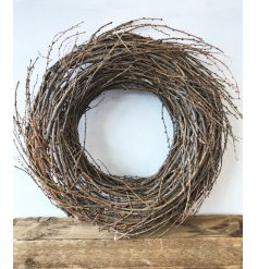 A charming natural twig wreath ideal for decorating the home and special events.