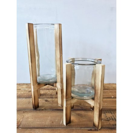 A chic and stylish candle holder with a distressed wooden framework.