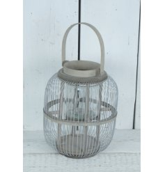A chic grey metal lantern with handle. Adding ambience to the home, garden and special events.