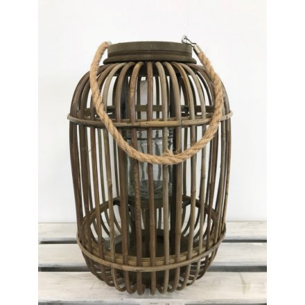 Stay on trend with this large natural wooden lantern complete with a chunky rope handle.