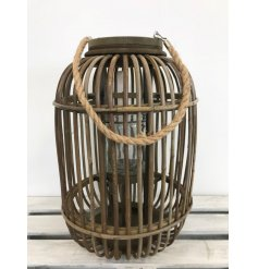 A large wooden lantern with chunky rope handle. A chic and on trend feature decoration for the home.