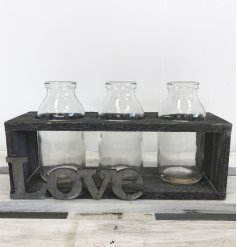 A rustic style wooden holder with a love sign. Complete with 3 mini milk bottles, ideal for displaying herbs and stems.