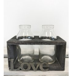 Display herbs or handpicked stems in this gorgeous rustic bottle holder with love sign.