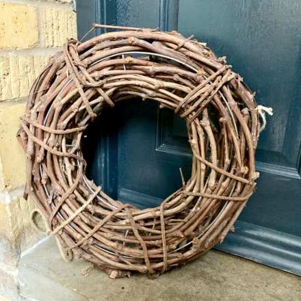 A charming large rustic wreath in natural brown. A beautiful interior and exterior decoration for the home and occasions