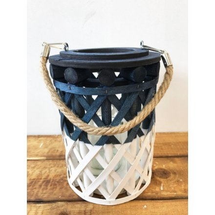 A chic white and blue two tone lantern with a woven pattern and chunky rope handle.