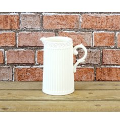 A charming, country style jug with ribbed detailing and a decorative rim. A shabby chic gift and interior accessory.
