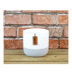 A natural ceramic pot with a contemporary grey and white finish. Complete with a nature tag.