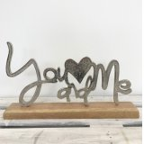 A beautiful you and me sign in silver set upon a chunky wooden base. A gorgeous gift item and interior decoration.