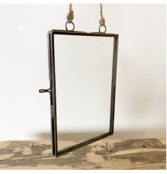 An antique inspired hanging photo frame with a rustic finish and jute string hanger.