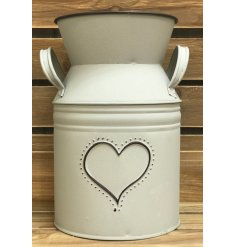 A charming metal churn featuring a matte grey tone and embossed heart decal