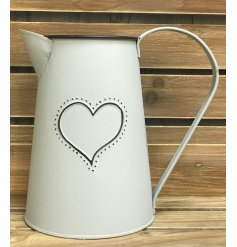 A charming metal jug featuring a matte grey tone and embossed heart decal