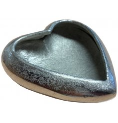 A stylish silver aluminium heart dish with a hammered finish. A chic gift item and interior accessory.