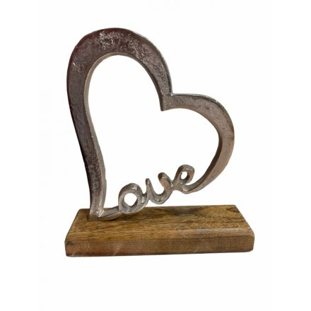 A stylish Love, heart shaped sign with a chunky wooden base. A unique heart decoration for the home