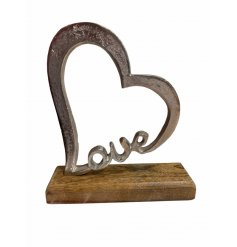 A stylish heart shaped ornament with a hammered finish and chunky wooden base.