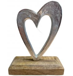A stylish aluminium heart decoration with a hammered finish and a chunky wooden base.